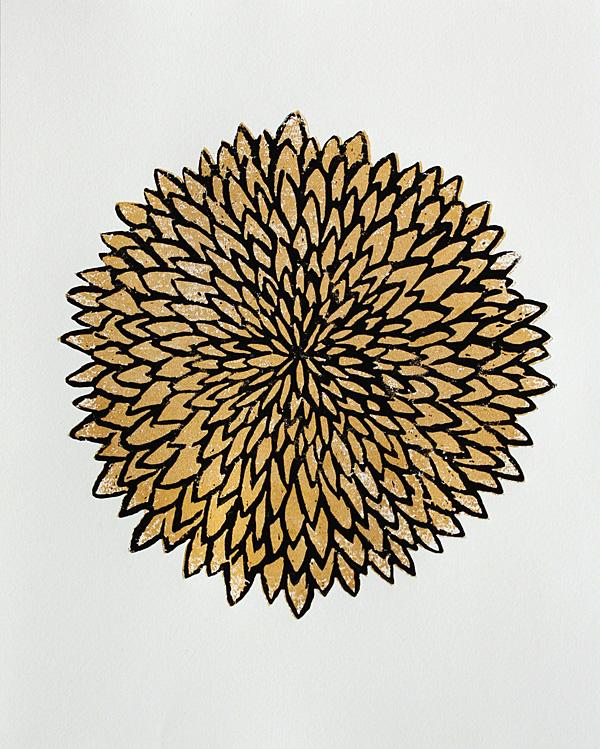 woodcut print of a golden chrysanthemum